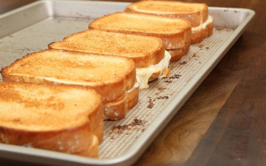 A row of grilled cheese sandwiches