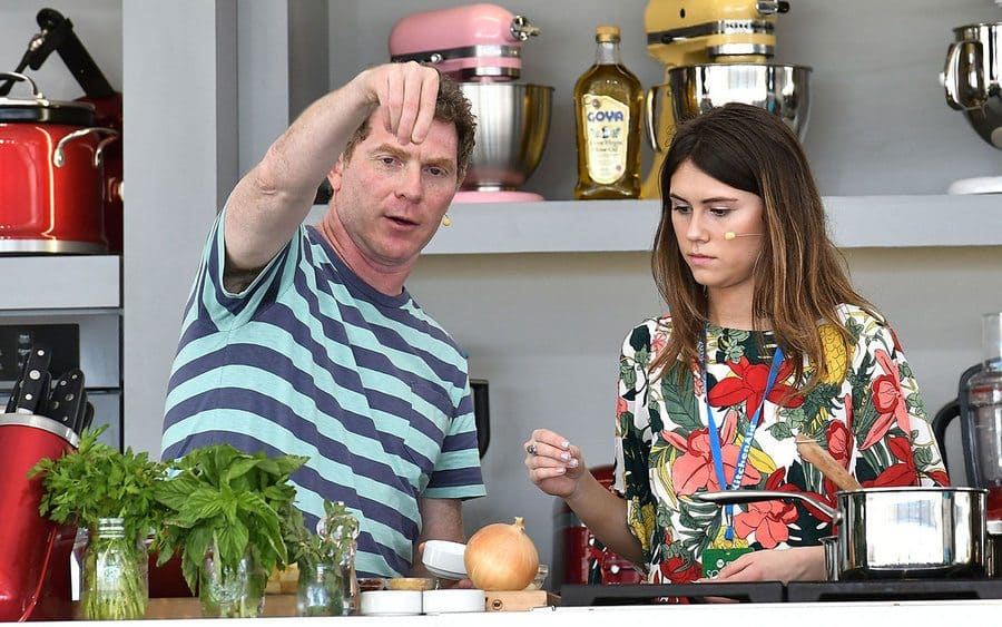 Bobby and Sophia Flay in the kitchen cooking