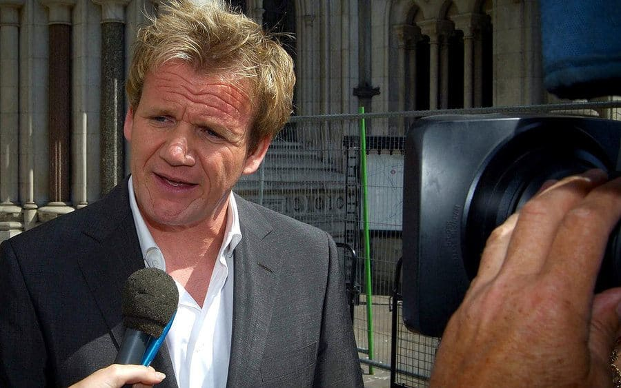 Gordon Ramsay is being interviewed outside of the courthouse after winning the case