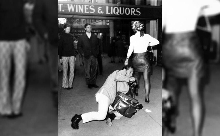 Jackie Kennedy Onassis supposedly flipping the paparazzi, Mel Finkelstein, on a Manhattan sidewalk, circa October 1969.