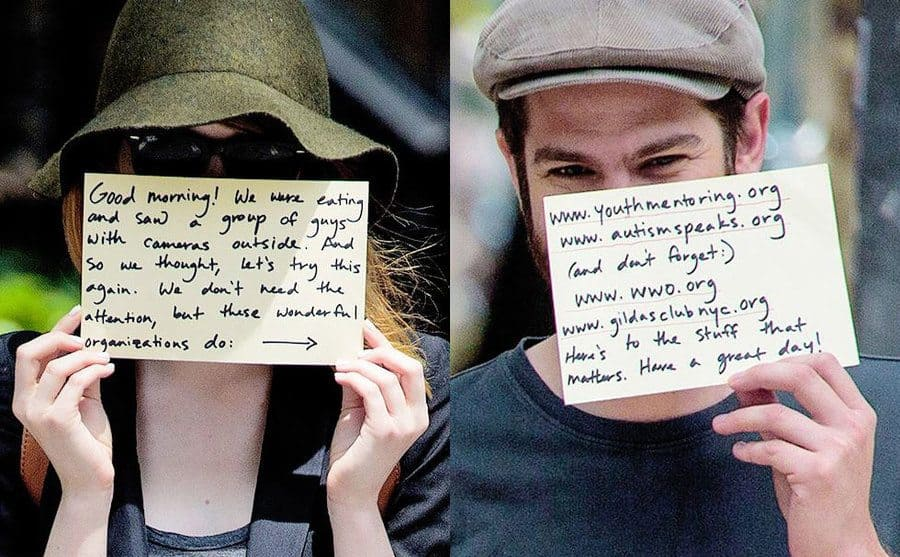 Emma Stone taking advantage of paparazzi being around, holding a sign up to her face pointing out organizations that could use the attention. / Andrew Garfield holding up the second sign with a list of organizations.