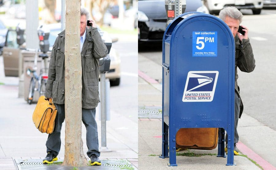 Dustin Hoffman hiding behind a tree, very clearly visible while talking on the phone. / Dustin Hoffman peeking out from behind a blue US Mailbox on a street corner.