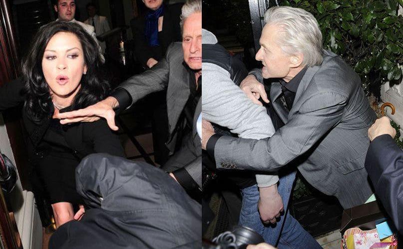 Michael Douglas attacks a photographer after he pushes Catherine Zeta-Jones.