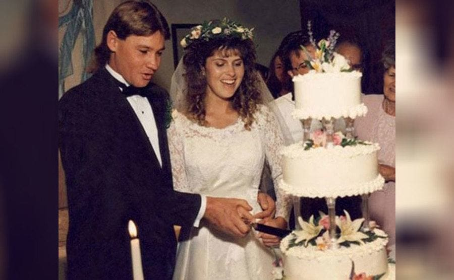 Steve and Terri cutting the cake on their wedding day