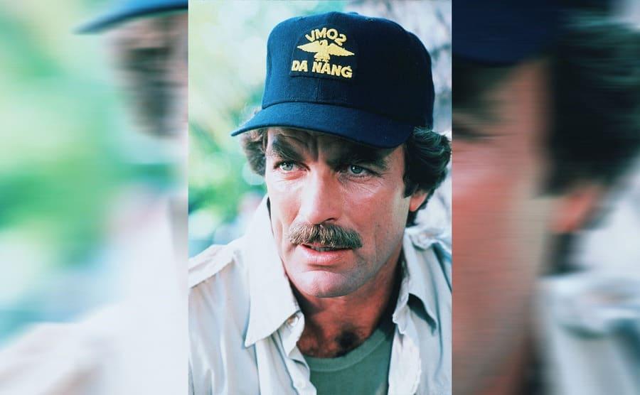 Tom Selleck wearing a Hawaiian shirt and his baseball hat