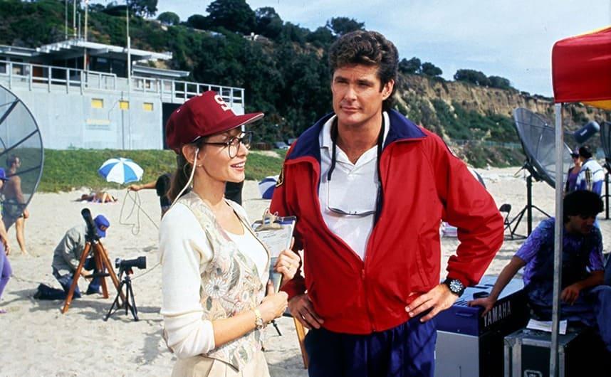 Alexandra Paul and David Hasselhoff standing on the beach in Baywatch