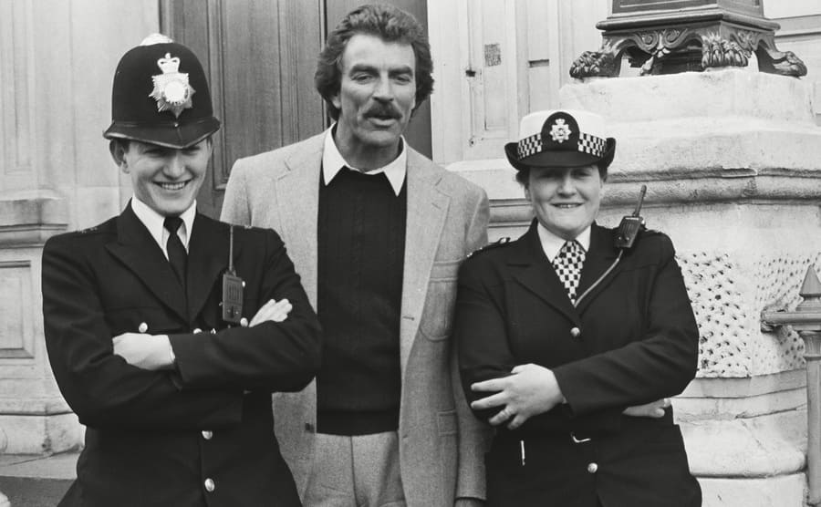 Magnum P.I. filming outside of a police station in London in April 1985, with Selleck posing with two female officers