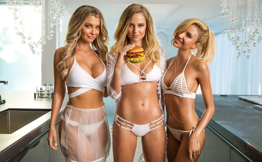 Genevieve Morton eating a burger with Emily and Elana