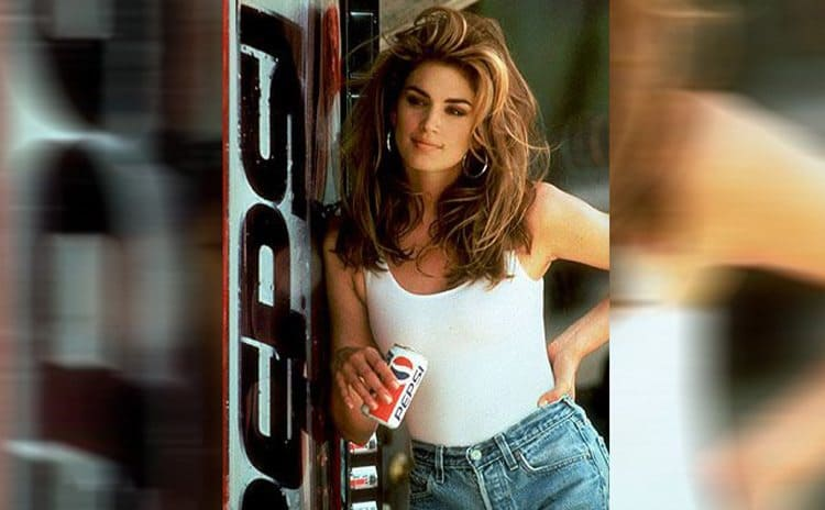Cindy Crawford holding a Pepsi can