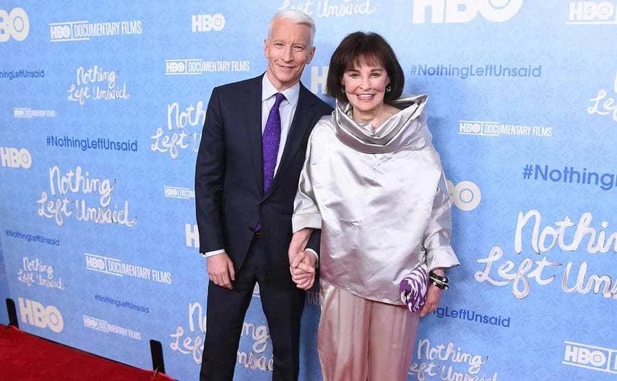 Andersoon Cooper holding Gloria Vanderbilt's hand on the red carpet in 2016