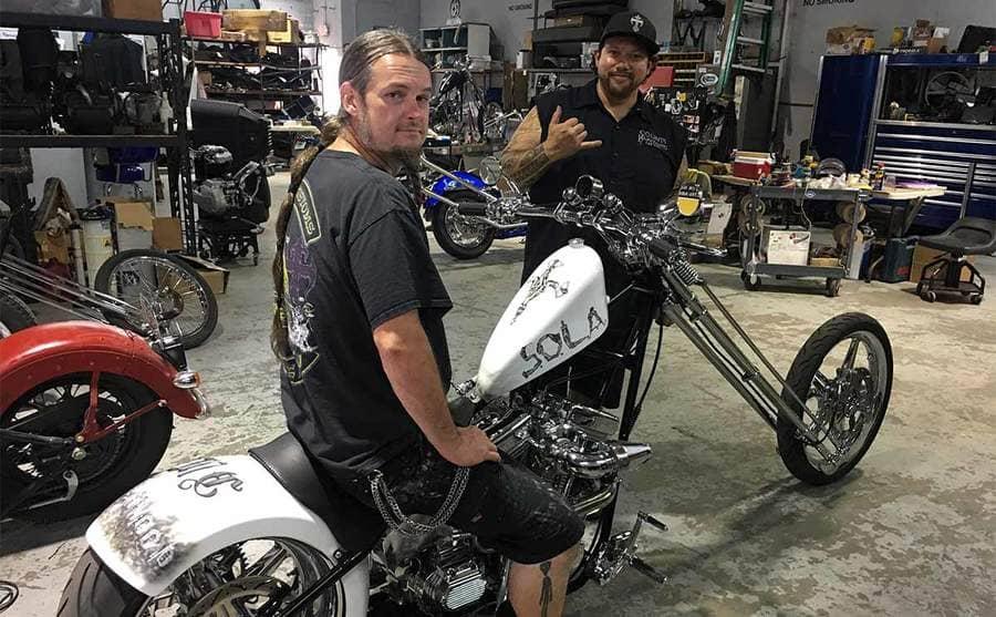 Joseph Frontier sitting on a custom bike