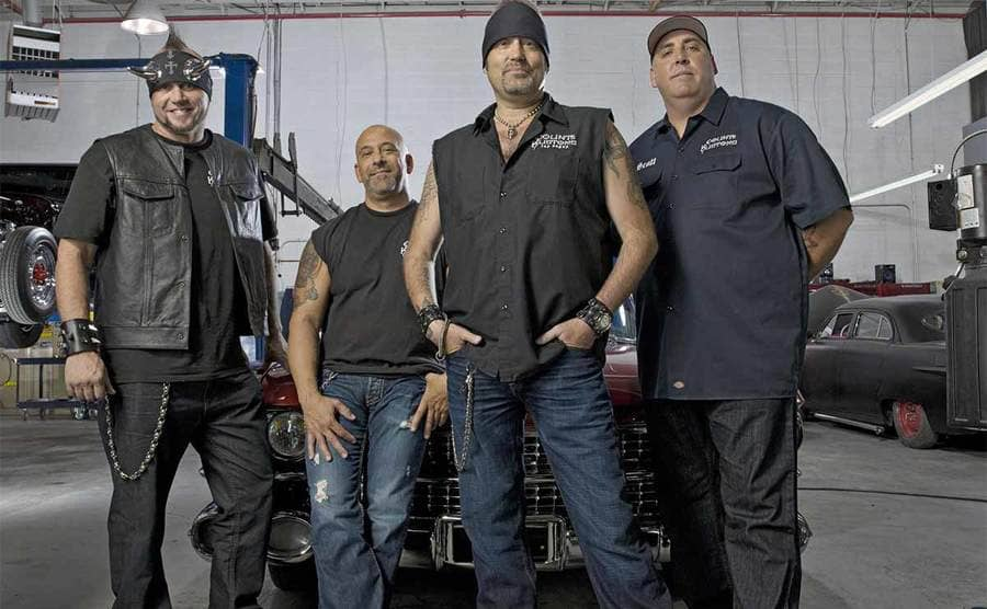 Horny Mike, Kevin Mack, Danny Koker, and Scott Smith posing in front of a car