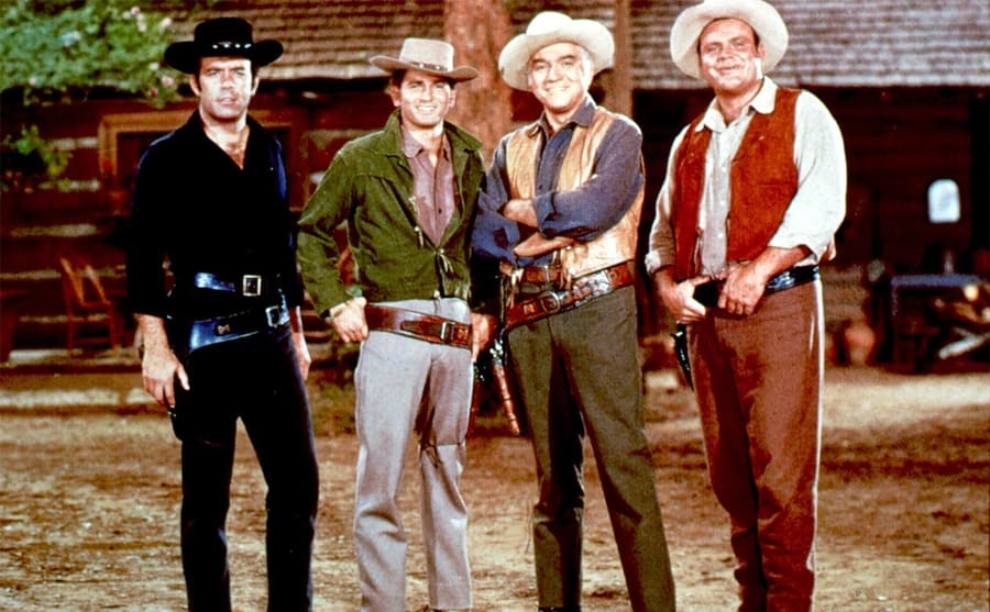 Pernell Roberts, Michael Landon, Lorne Greene, and Dan Blocker posing in their cowboy gear on the show Bonanza