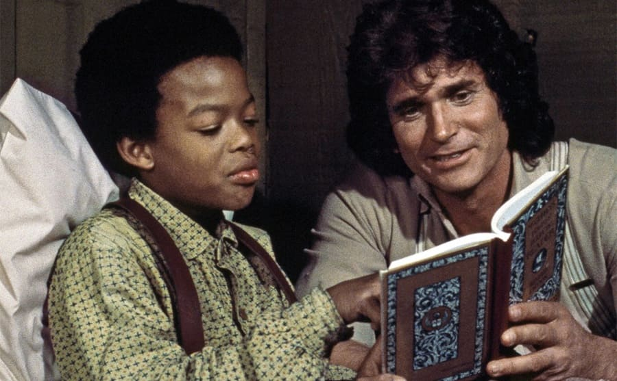 Michael Landon reading Todd Bridges a book on the show Little House on the Prairie