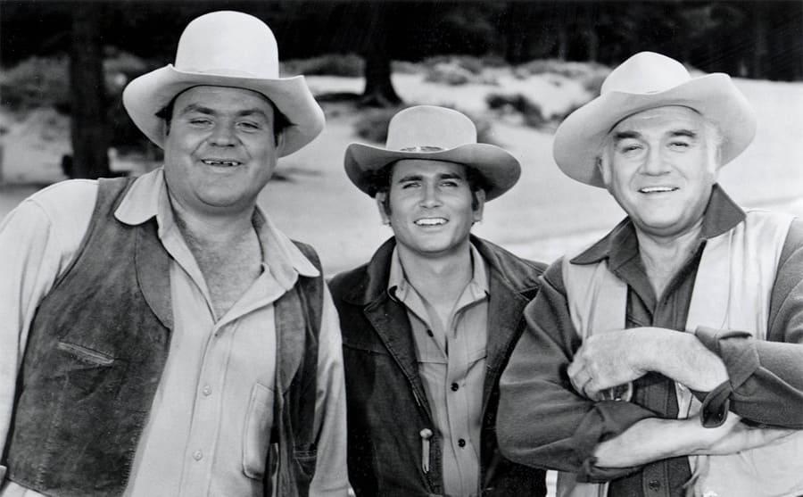 Dan Blocker, Michael Landon, and Lorne Green posing in cowboy outfits