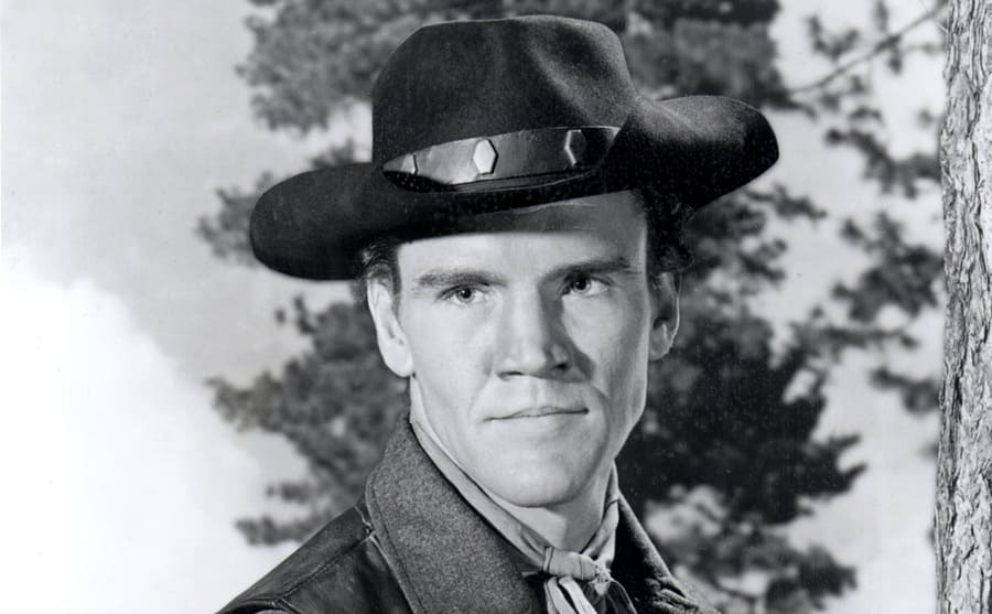 David Canary with a cowboy hat on in a scene from Bonanza