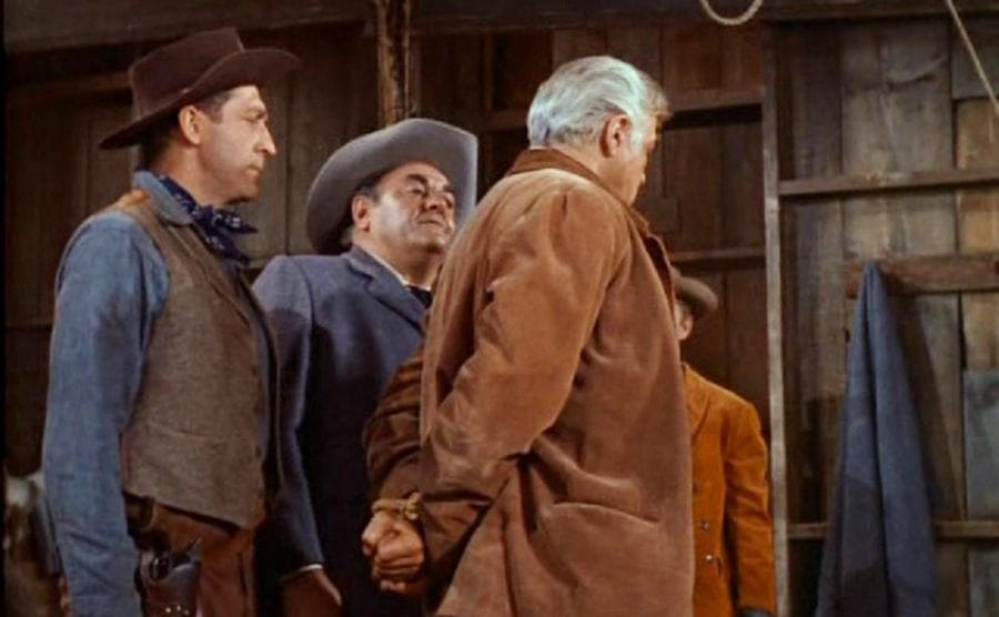 Lorne Greene with his hands tied behind his back in a scene from Bonanza
