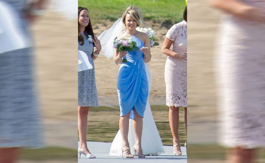 Rachel McAdams in a short baby blue dress