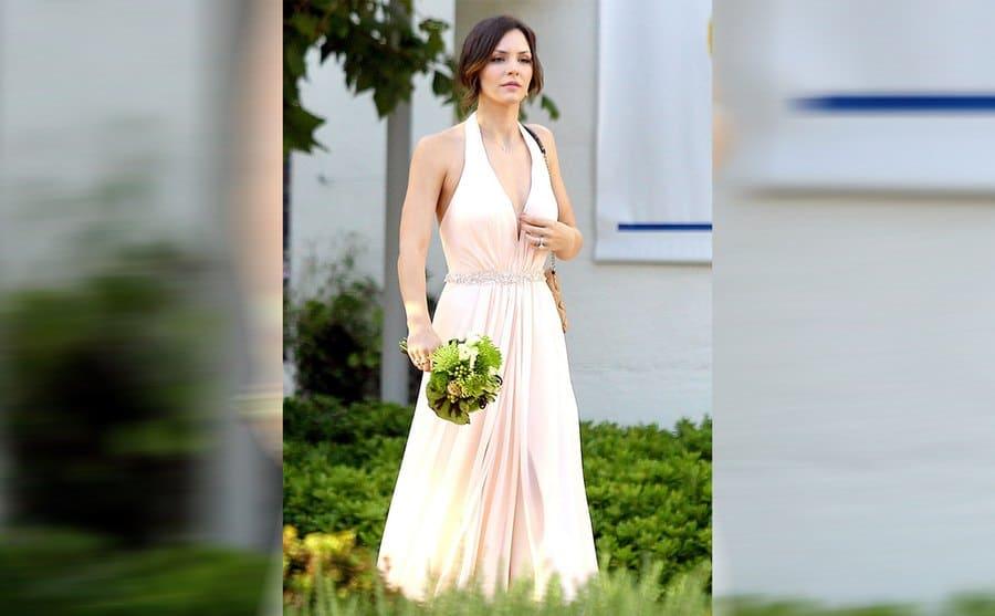 Katharine McPhee walking around in a sleeveless light pink dress