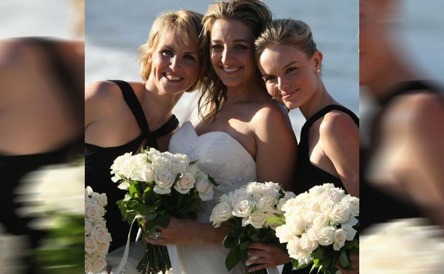 Kate Bosworth in a black dress with the bride and another bridesmaid