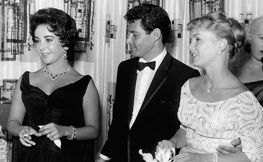Elizabeth Taylor, Eddie Fisher, and Debbie Reynolds posing together