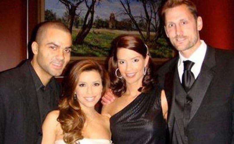 Tony Parker, Eva Longoria, Erin Barry, and Brent Barry posing together at an event