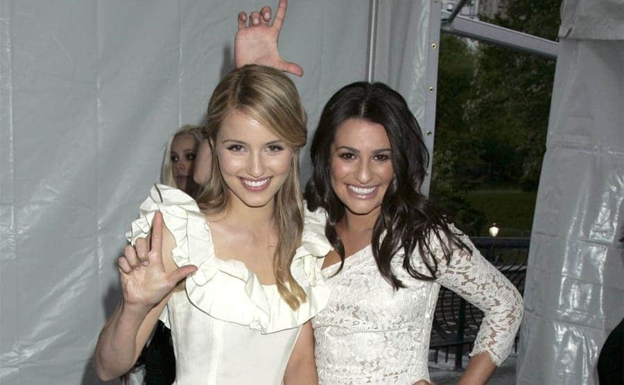 Dianna Agron and Lea Michelle on the red carpet posing together goofily
