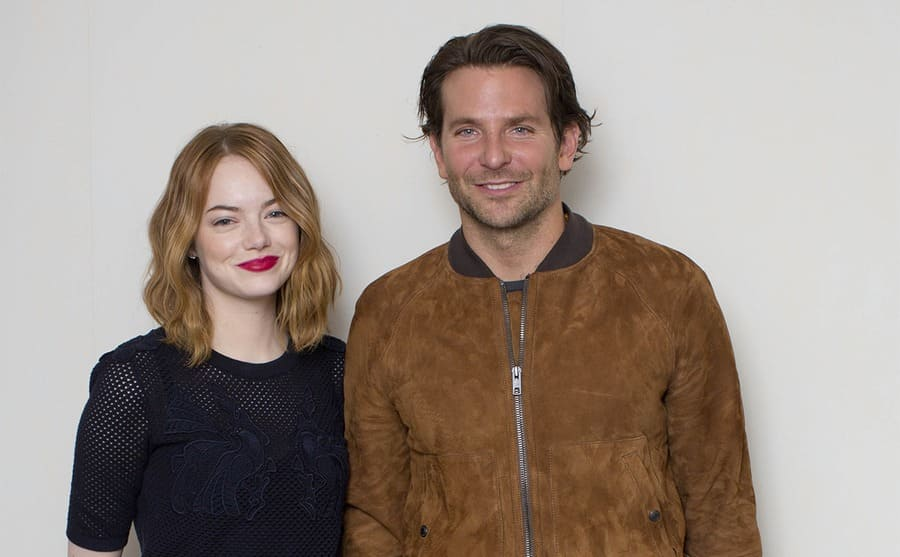 Emma Stone and Bradley Cooper posing together