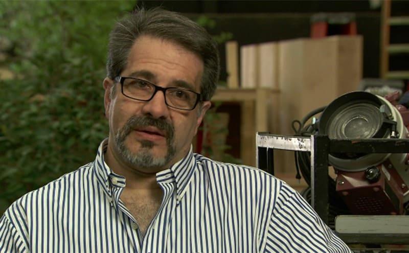 Tony DeRosa-Grund being interviewed on a movie set