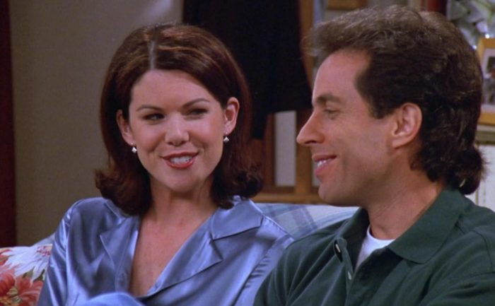 Lauren Graham and Jerry Seinfeld sitting on a couch together