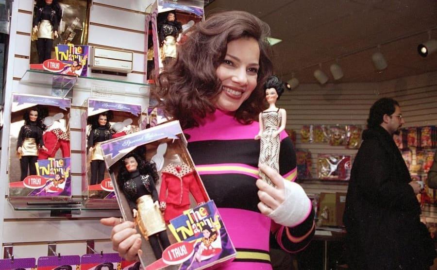 Fran Drescher holding a Fran Fine barbie doll