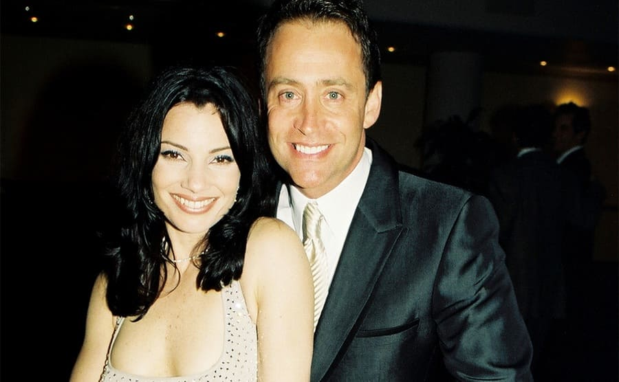 Fran Drescher and Peter Marc Jacobson posing together at a movie premiere in 1997