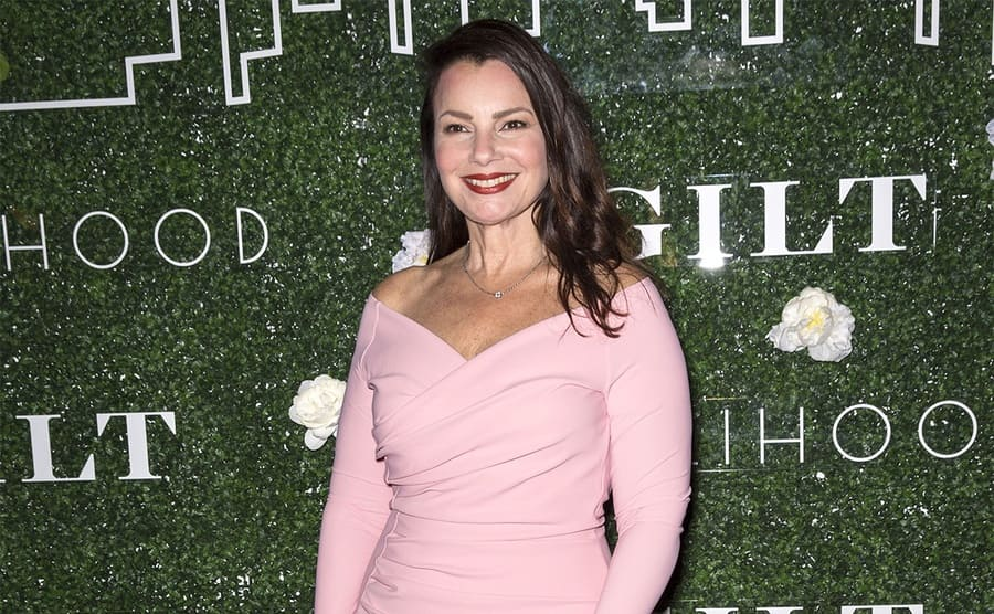 Fran Dresher in a pink dress on the red carpet in 2017