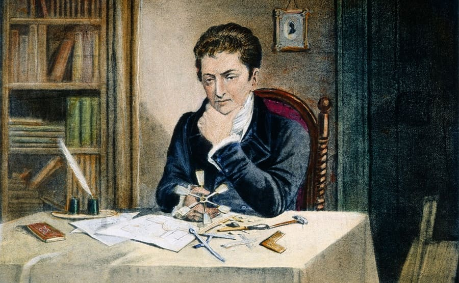 An illustration of Robert Fulton sitting at a table working