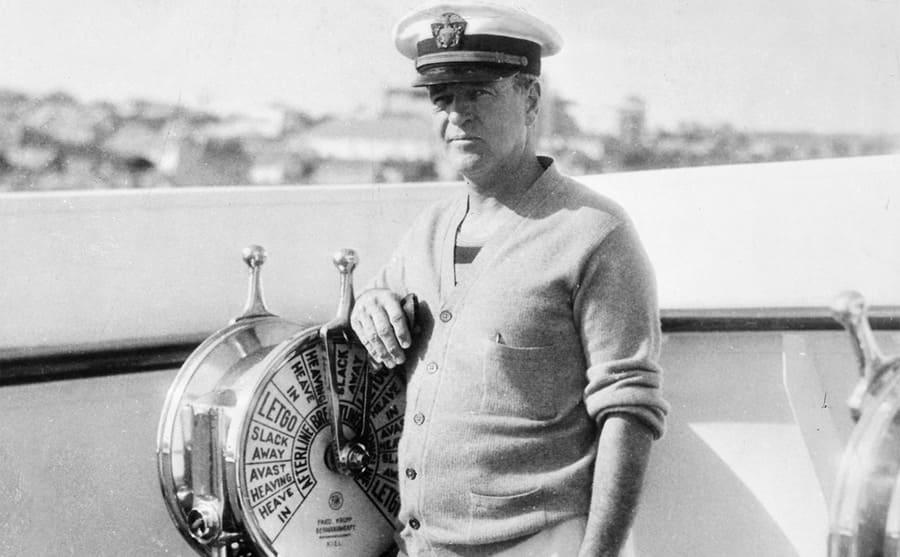 William Kissim Vanderbilt standing behind the yacht controls