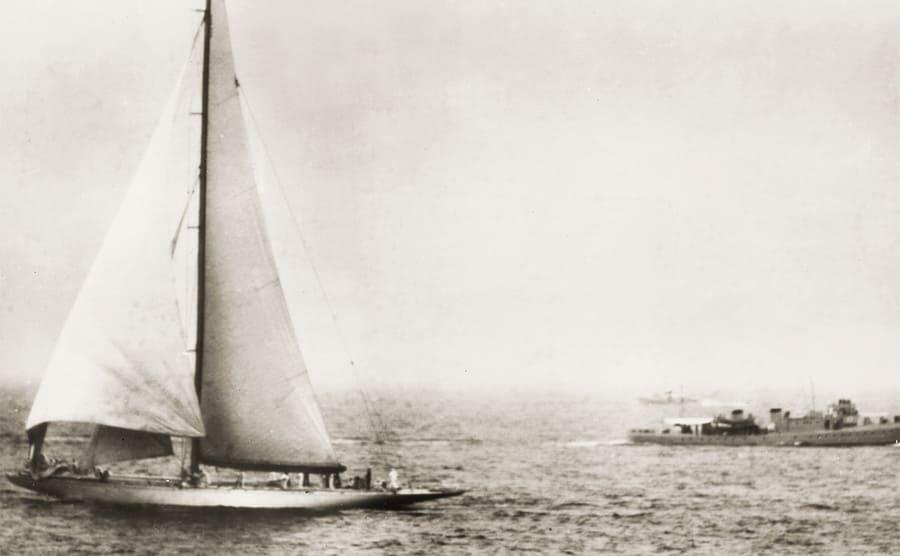 Harold Stirling Vanderbilt out of view, racing his sailboat