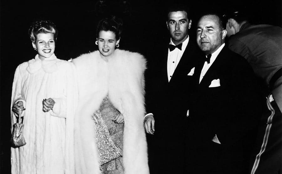 Rita Hayworth and Gloria Vanderbilt dressed up for an event circa 1940