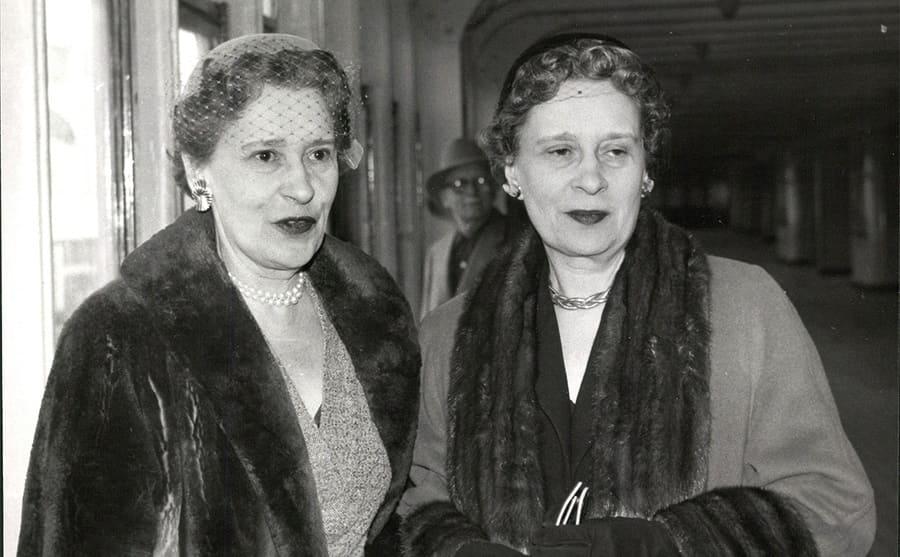 Gloria Vanderbilt with her twin sister wearing fur