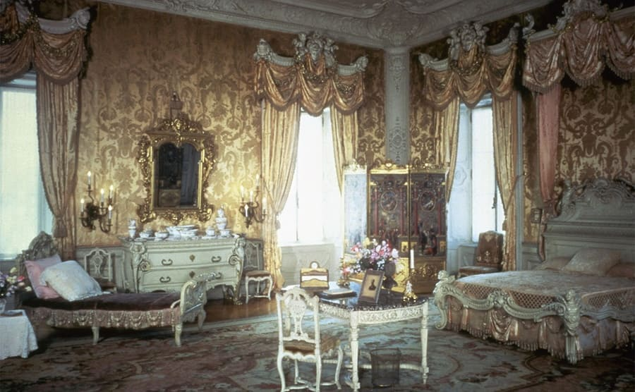 A photograph of one of the master bedrooms at the Vanderbilt's mansion in Rhode Island