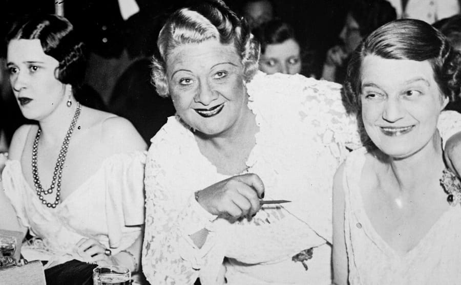 Gloria Morgan, Sophie Tucker, and the Grand Duchess Marie of Russia sitting around a table at a charity event in April 1935