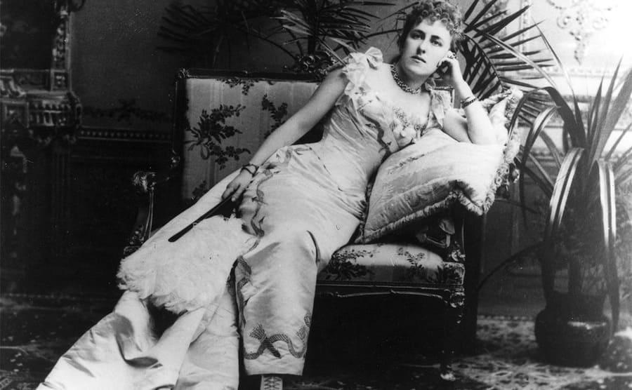 Louise Vanderbilt posing on a fancy chair
