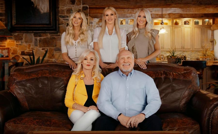 Terry Bradshaw in his living room with his wife and three daughters