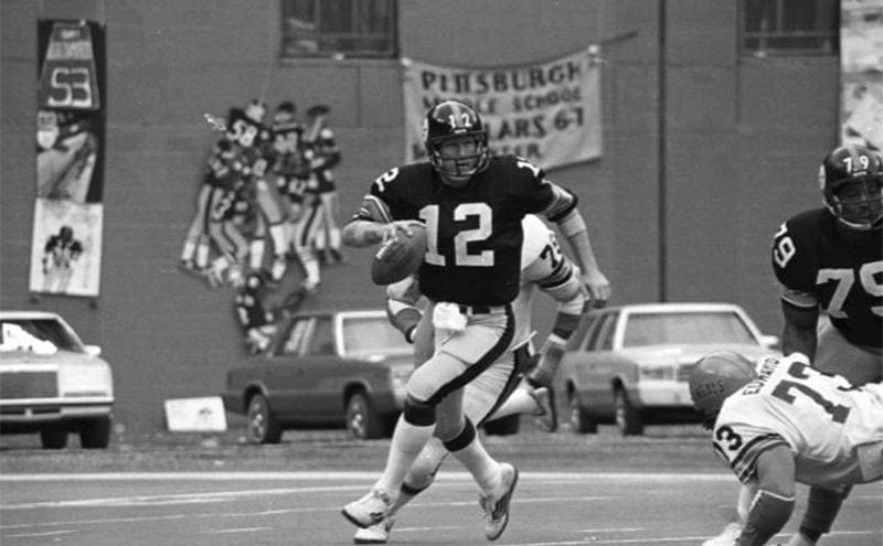 Terry Bradshaw running with the ball during a 1970s Steelers game