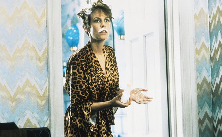 Jamie Lee Curtis with foils in her hair and bleach on her upper lip coming out of the bathroom in the film A Fish Called Wanda