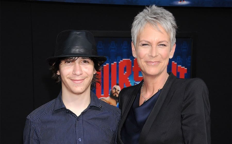 Jamie Lee Curtis posing on the red carpet with her son Tom 2012