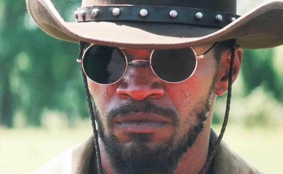 Jamie Foxx wearing circular sunglasses in the film Django Unchained