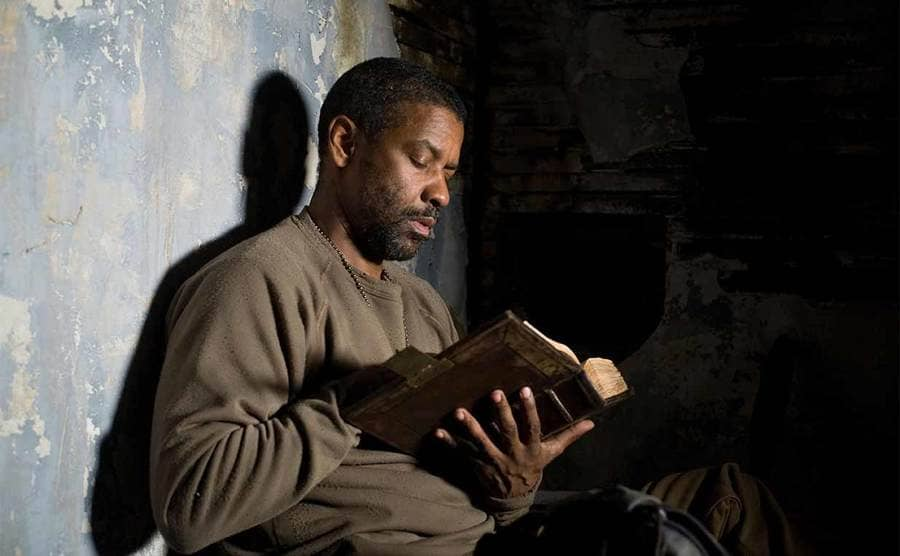 Denzel Washington reading from the Bible in The Book of Eli