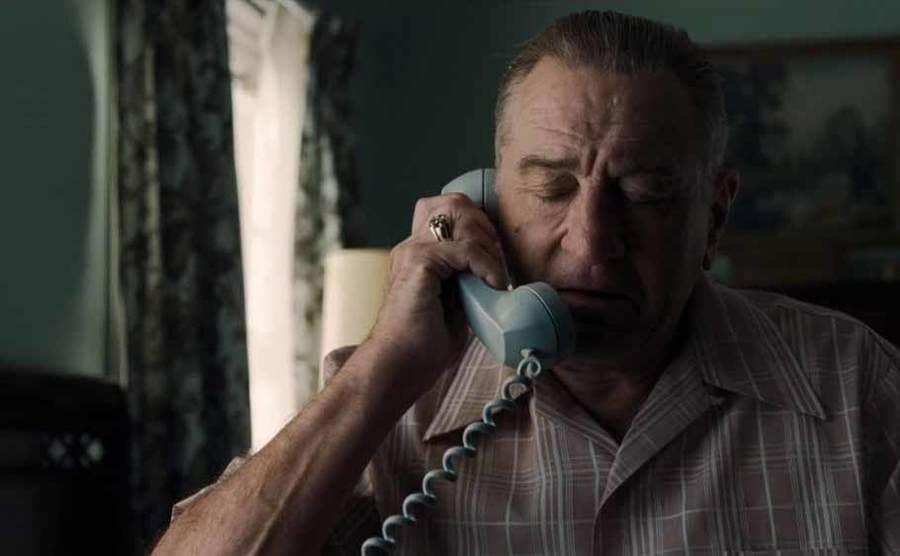 Robert DeNiro as Frank Sheeran on the phone in The Irishman