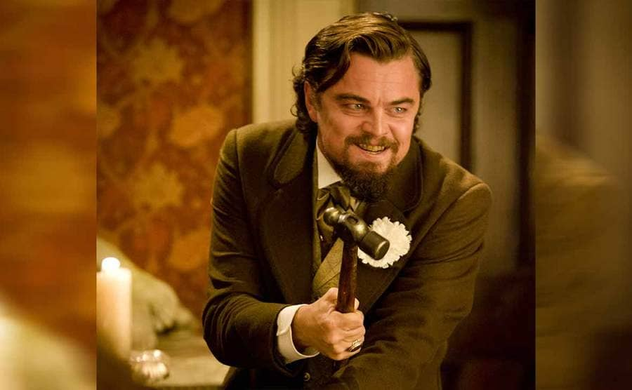 Leonardo DiCaprio holding a hammer in the film Django Unchained