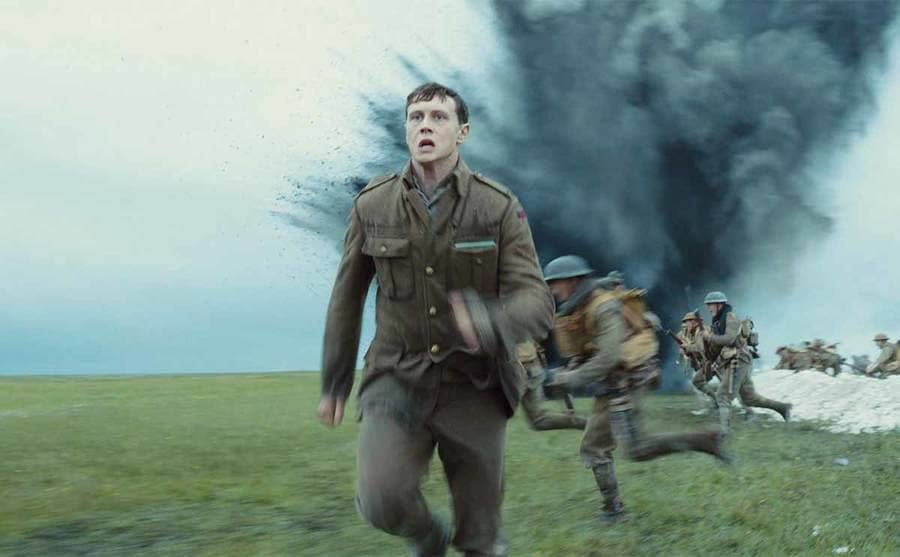 George Mackey running from an explosive in the film 1917